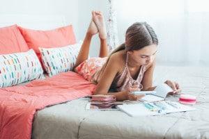 Pre teen girl doing school homework